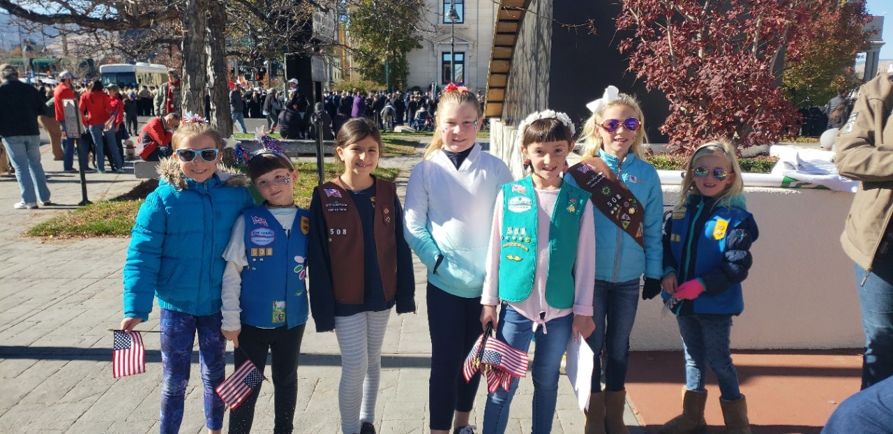 Girl Scout troop prepares to march in Veterans Day Parade